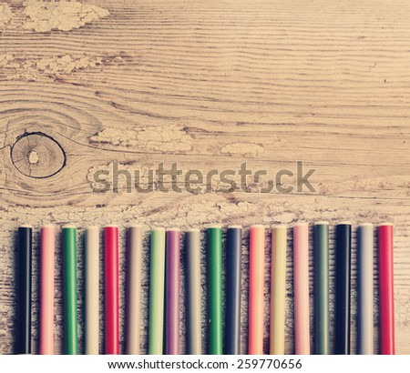 Office supply background: colorful marker pens on wooden table background. Back to school, business background - stock photo