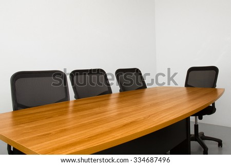 office table in small white room with chairs - stock photo