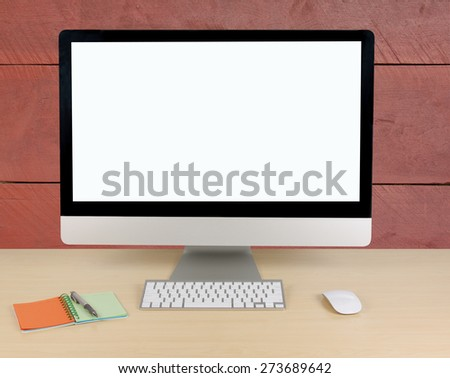 Office table with computer and paper note on red wood wall - stock photo