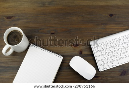Office table with notebooks, computer and computer mouse. Free space for text or picture. - stock photo