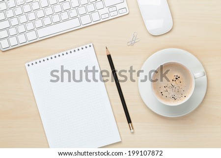 Office table with notepad, computer and coffee cup. View from above - stock photo