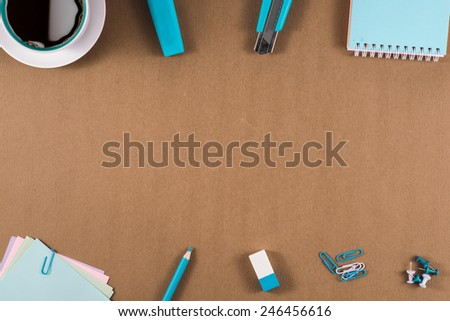Office table with notepad, computer, coffee cup and flower. View from above with copy space - stock photo