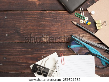Office table with notepad, vintage envelope and supplies. View from above - stock photo