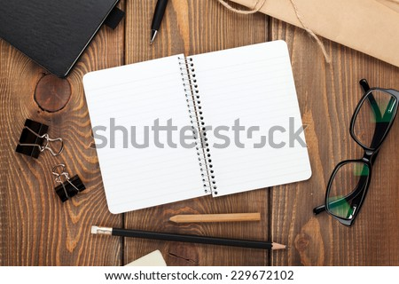 Office table with notepad, vintage envelope and supplies. View from above with copy space - stock photo
