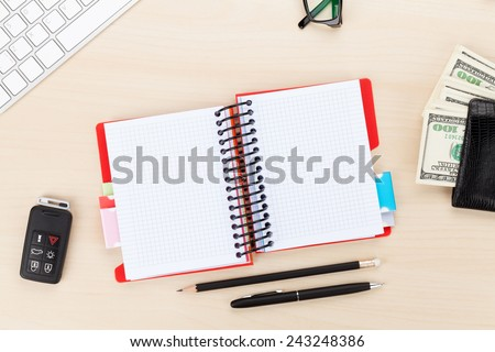 Office table with pc, supplies and money cash. View from above with copy space - stock photo