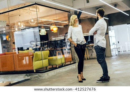 Office talk between colleagues at work - stock photo