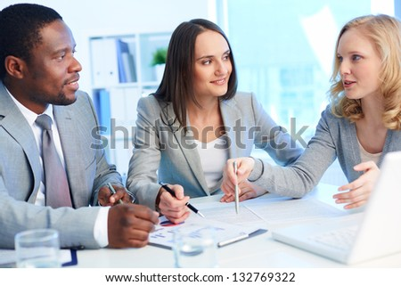 Office team working with business documents - stock photo