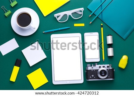 Office tools. Digital technology. Innovative implementation in business. Internet applications. Wireless function. Tablet phone and camera Developing applications on the Internet. Flat lay photo - stock photo