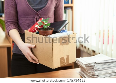 Office white collar worker with things collected in a box - stock photo
