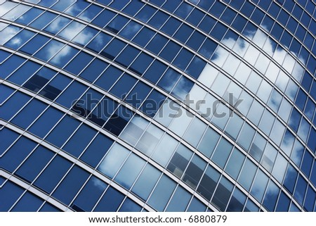 Office windows with a clouds reflection - stock photo