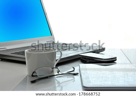 office with computers and phones last generation - stock photo