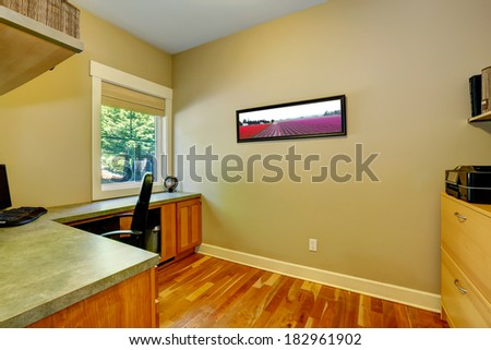 Office with corner desk. View of window, desk and wall picture - stock photo