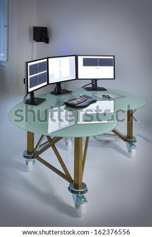 office with table desktop computer an keyboard - stock photo
