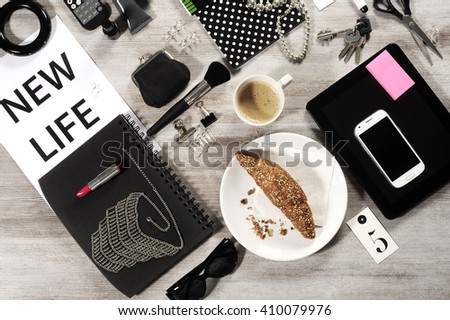 Office wooden desk table with mobile and tablet, supplies and coffee cup. Top view with copy space - stock photo