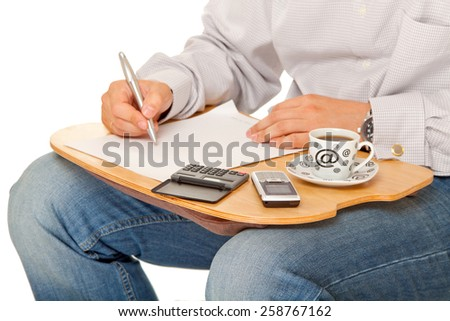 Office work. Man writing with coffe. Isolated on white. - stock photo