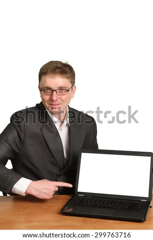 Office worker holding blank computer monitor with clipping path for the screen
