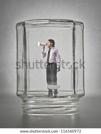 Office worker, in a glass container, screaming - stock photo