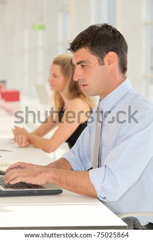 Office worker in the office - stock photo