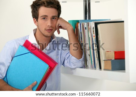 Office worker posing with his files - stock photo