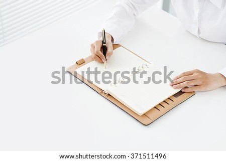 Office worker setting business plans and meetings