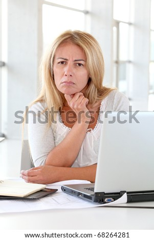 Office worker sitting at her desk