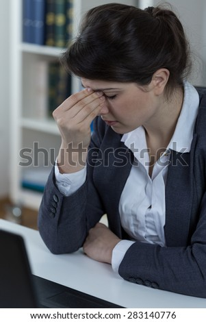 Office worker suffering from sinusitis  - stock photo