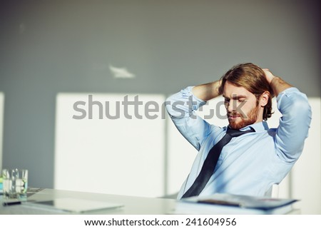 Office worker taking a pause at his workplace - stock photo