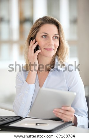 Office worker talking on the phone - stock photo