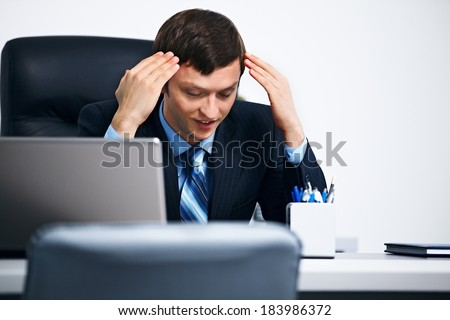 Office worker trying to relax in office