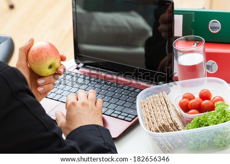 Office worker who are eatingl during the work  - stock photo