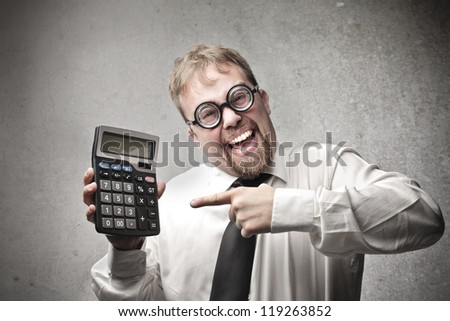 Office worker, with a pair of strange glasses, showing a calculator - stock photo