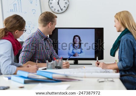Office workers during business conference on the skype - stock photo