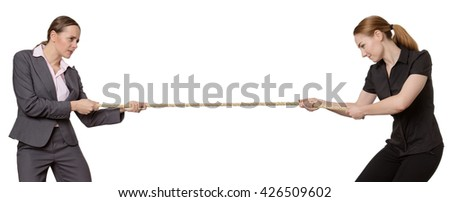 office workers pulling on rope in a tug of war.   - stock photo