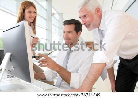 Office workers with manager in a meeting