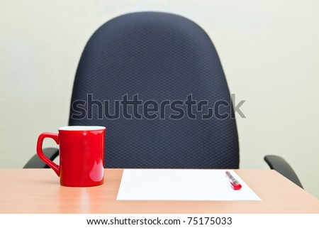 Office workplace and red cup - stock photo