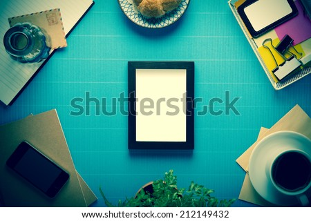 Office workplace,office Equipment and coffee break on blue crepe paper desk,Cross Process - stock photo