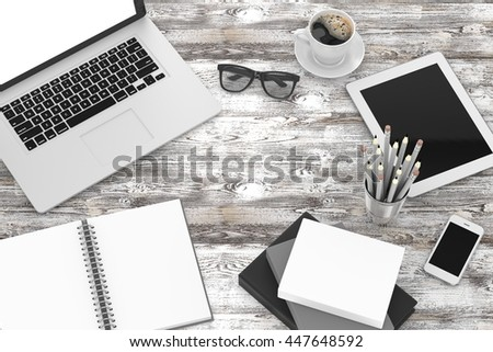Office workplace set on wooden grey table. Pc, tablet, smartphone, notebook, stationery, glasses, cup of coffee.