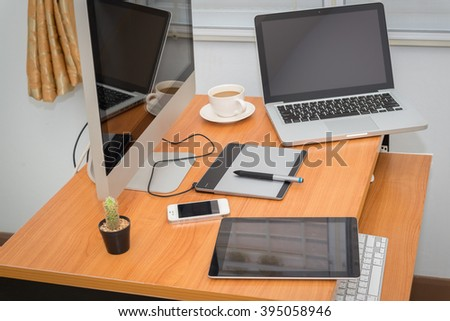 Office workplace with laptop and smartphone on wood table