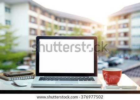 Office workplace with laptop notepad pen coffee of cup and smartphone on marble table. - stock photo
