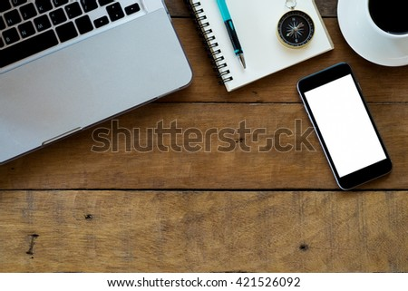 Office workspace with laptop,blank screen smartphone, coffee cup ,pencil and notebook.Flt lay photo.Top view with copy space - stock photo