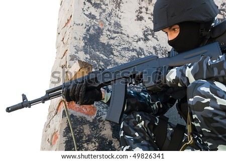Officer in full ammunition targeting with automatic russian AK47 rifle - stock photo