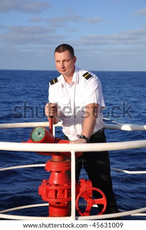 officer on watch check fire-equipment on board of chemical tanker - stock photo