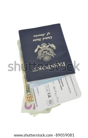 Official American Passport Airline Ticket International Traveler U.S. Currency - stock photo