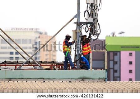 Officials are checking the transmitter Trust's telephone. - stock photo