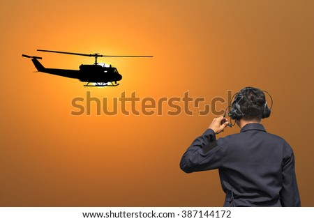 Officials are communicating with helicopter mechanic - stock photo