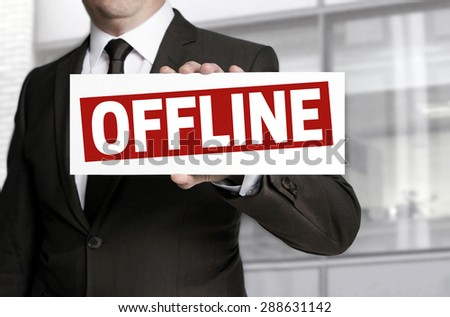 offline sign is held by businessman. - stock photo