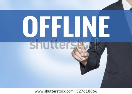 Offline word on virtual screen touch by business woman blue background - stock photo