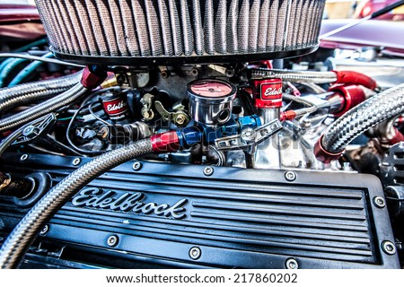 OFFORD DARCY, CAMBRIDGESHIRE, UK - 08 JUNE 2014:  A V8 Sports car receives final tuning prior to customer delivery after a rebuild by a custom motor tuners on JUNE 08 2014 in Offord Darcy. - stock photo