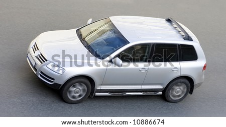 """offroad car on street shot from top - See similar images of this """"Luxury Cars"""" series in my portfolio - stock photo"""