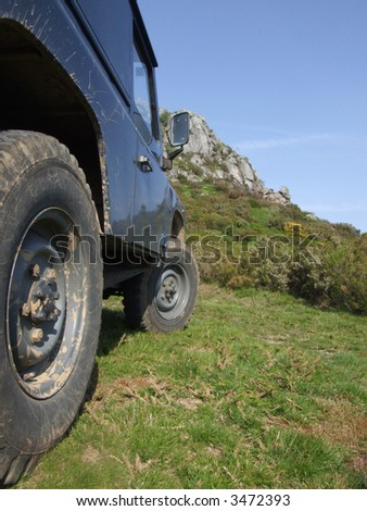 Offroad vehicle and a mountain in the background